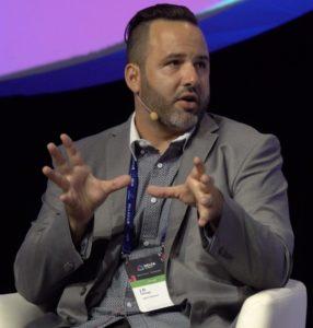 J.D. Salbego speaks main stage at Delta Summit - security token offerings